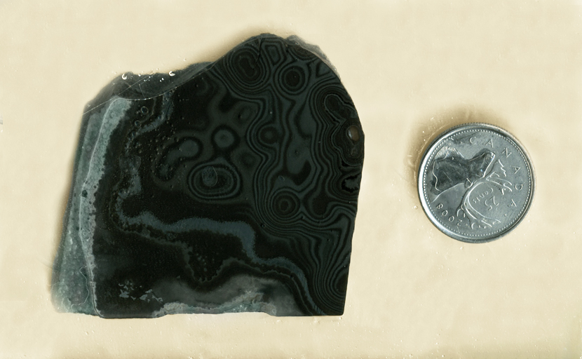 Oozing black and gray patterns on a slab of Psilomelane (Merlinite) from Mexico - Manganese in Agate.