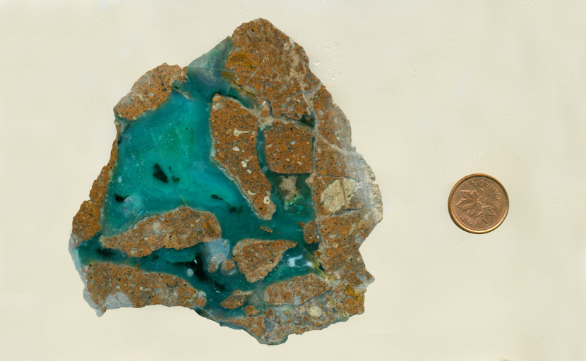 Translucent bright blue chalcedony in broken brown matrix.