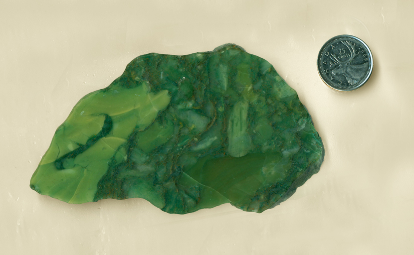 Slab of green Chrome Chalcedony from Africa, with complex blotches of light and dark.