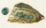 Central sagenite bursts with lacy green, red, pink and blue on the outside, in a slab of Sagenite Lace Agate from Mexico.