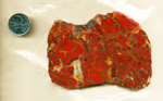 Slab of red patterned Brecciated Jasper from Africa, with each gap filled in with white and colorless chalcedony.