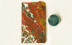 Red flower-patterns in a black, yellow and white slab of Morgan Hill Poppy Jasper from California.