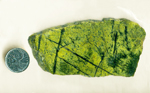 Bright green slab of Pistachio Serpentine with black veins, from Mexico.
