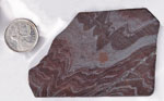 Flowing metallic reddish, silver and black patterns in a slab of Tiger-Iron from Australia.