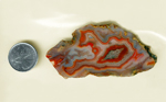 A Laguna Agate slab from Mexico, blue with a bubbly waving red pattern spread across it, with a red fortification in the center.