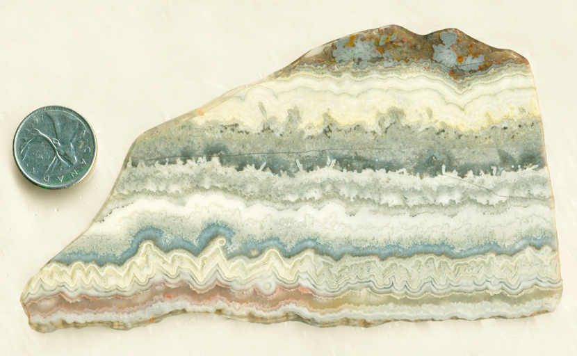 Blue, red and gold slab of Mexican Dogtooth Lace Agate from Mexico, with tooth and lace patterns.