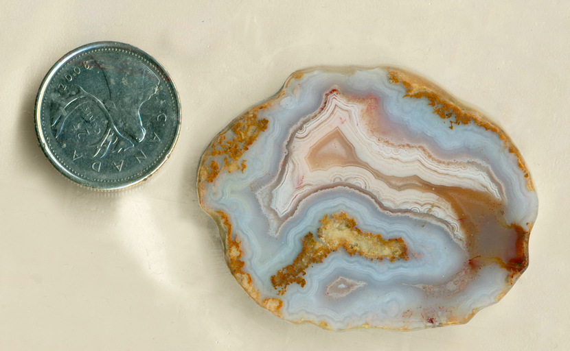 Blue, yellow, pink and orange slab of Mexican Snowball Agate, with two fortification patterns.