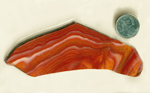 Yellow, brown, red, pink and white flowing lines in a slab of Mexican Hickoryite (Aztec Miracle Stone), a type of Rhyolite.