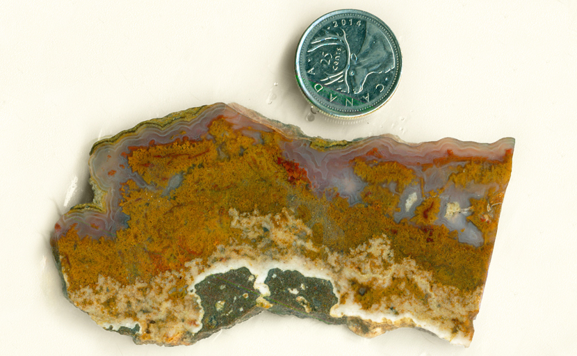 Orange, purple, red and blue slab of Cathedral Agate from Mexico.