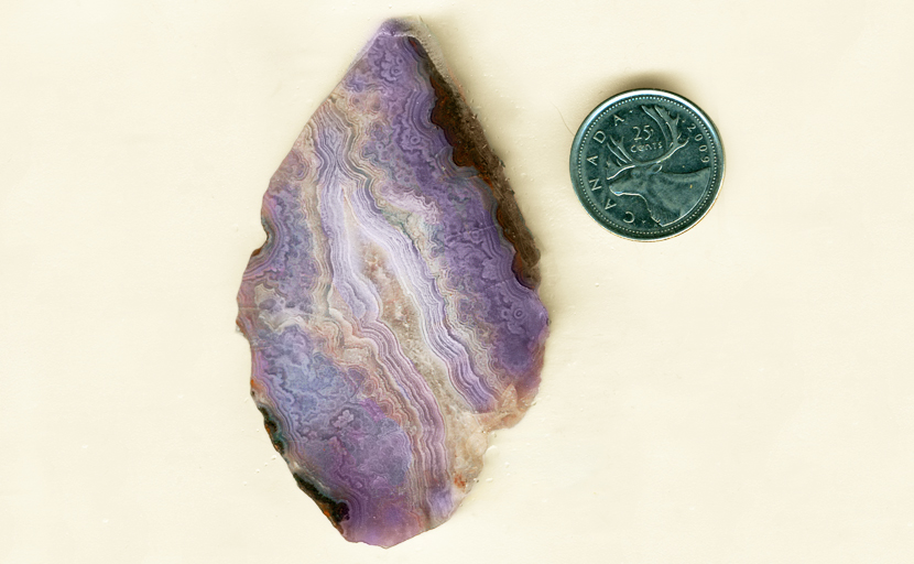 Purple lacy Royal Aztec Agate from Mexico, with a deep color, in a candle-flame shape.