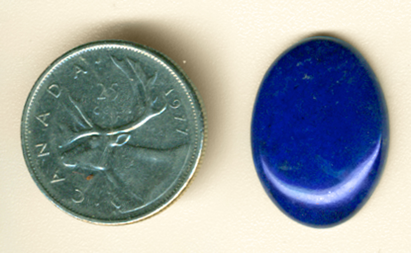 Afghani deep blue Lapis Lazuli oval cabochon with a touch of violet.
