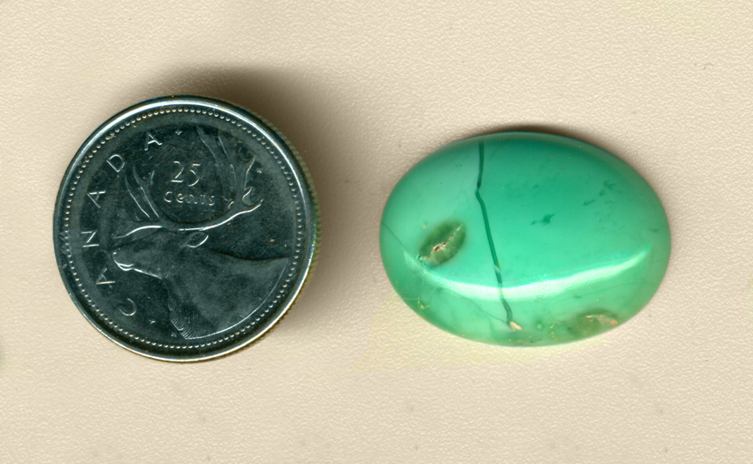 Calibrated oval polished Citron Chrysoprase cabochon from Australia, bright blue-green with a line and a clear spot running through it.