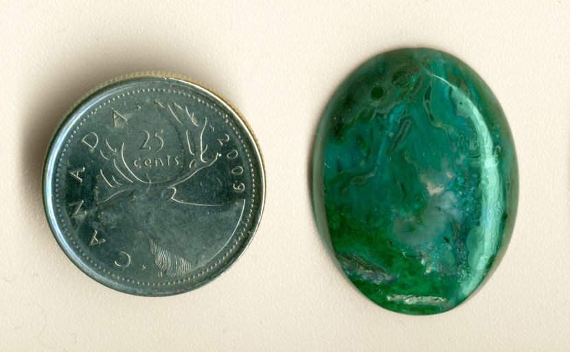 Bright blue and green streamers preserved by agate in a cabochon of Chrysocolla-in-Chalcedony.