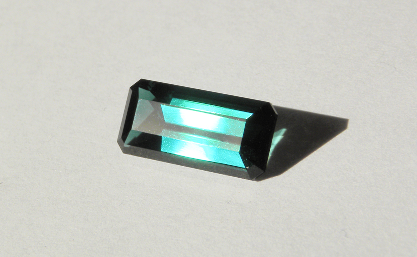 Bright blue-green step-cut faceted Tourmaline from Africa.