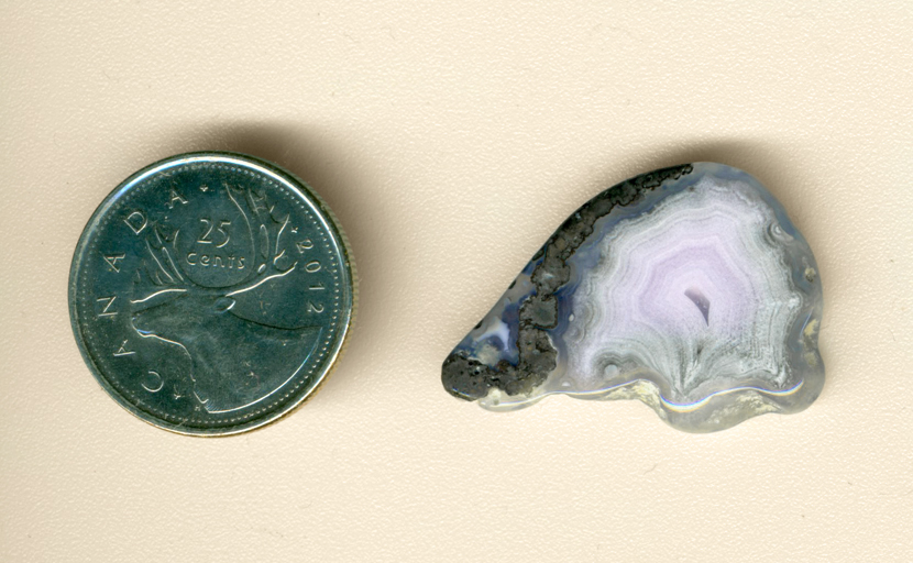 Pinkish-purple and violet-blue freeform polished Parcelas Agate from Mexico.