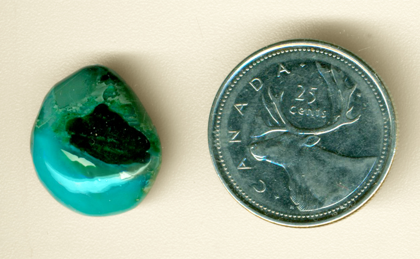 Bright blue and green patterned cabochon in Chrysocolla-in-Chalcedony from the Inspiration Mine in Globe County, Arizona.