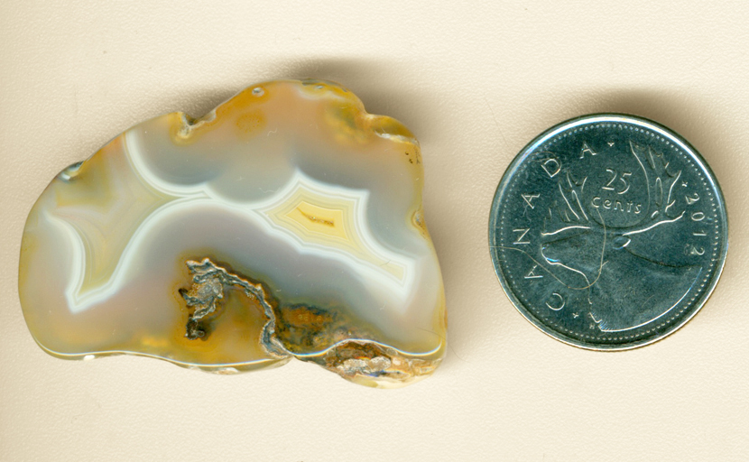 Blue, white and yellow polished Moctezuma Agate from Mexico with two fortification patterns.