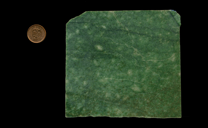 A square slab of Emerald Snowflake Jade, mottled green, heavy and dense.