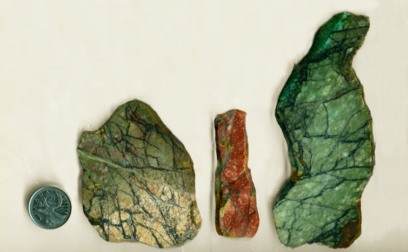 3 slabs of Green and Red Jasper, with lines like forest shadows and details of other colors.