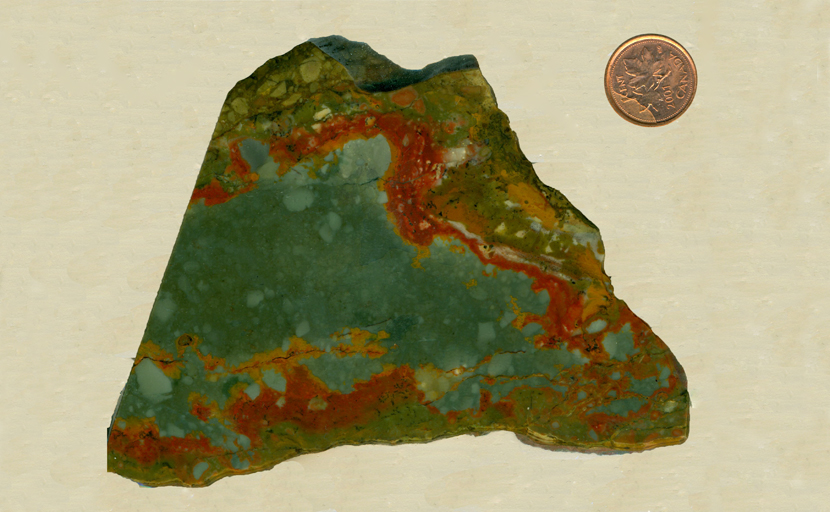 A slab of scenic Rocky Butte Jasper from Oregon, with a blue-green sky and red ground on three sides, with green patterns underneath.