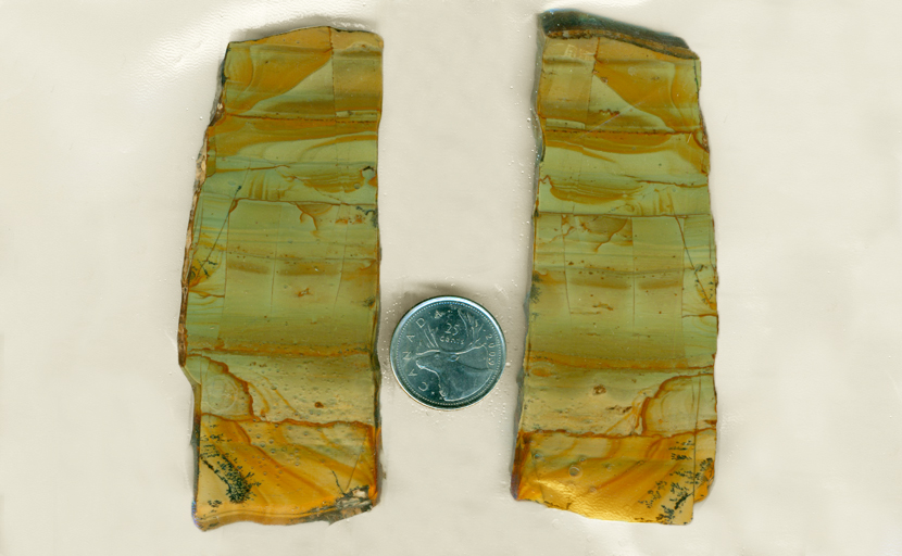2 slabs of Succor Creek landscape jasper from Oregon, with orange and yellow on a blue-green background.
