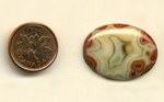 Calibrated oval polished Fairburn Agate cabochon from Nebraska or South Dakota, with a creamy star pattern, bordered by layers of red chalcedony.
