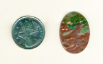 Calibrated polished Fancy Jasper cabochon from India, part green and part burgundy, with flecks of gold and sea-blue.