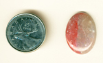 Cabochon of bright pink Myrickite, with two shades of pink, one on either side of the stone.