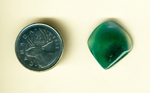 Bright blue-green shape floating in clear gem silica, a Malachite Crystal in Gem Silica from Globe Co., Arizona.