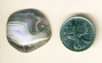 White, purple and gray fortification patterns in a freeform cabochon of Parcelas Agate from Mexico.
