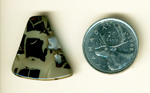 Solid brecciated harlequin black shapes on a creamy background in a freeform Willow Creek Jasper.