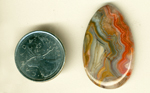 Orange, blue and yellow fortification patterns in a teardrop-shaped polished Crazy Lace Agate from Mexico.