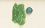 Bright bluish-green shapes in a slab of Vesuvianite, also called Californite, Idocrase or Happy Camp Jade.
