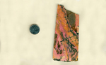 A rectangular slab of Rhodonite from West Virginia, streaked with pink, yellow and black.