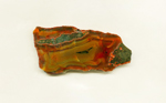 A slab of Condor Agate from Patagonia, with orange and yellow patterns and traces of green matrix.
