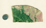 A slab of Pink and Green Jade from Wyoming, equal parts pink Thulite and Green Jade, joined in an uneven line.