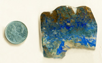 Shattuckite and Ajoite slab with lines and splashes of lapis-blue and green across a brown and tan background.
