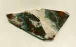 Earthy reds and brown mottled patterns on a triangular Jaspalite slab from Africa