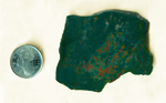 Slab of Bloodstone from India, with red-orange droplets splattered on a deep green surface.